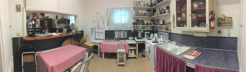 The kitchen space filled with objects and equipment.